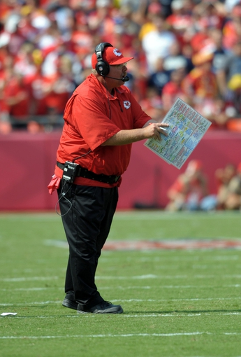 Sep 15, 2013; Kansas City, MO, USA; Kansas City Chiefs head coach Andy Reid calls in plays during the second half at of the game against the Dallas Cowboys Arrowhead Stadium. The Chiefs won 17-16. Mandatory Credit: Denny Medley-USA TODAY Sports