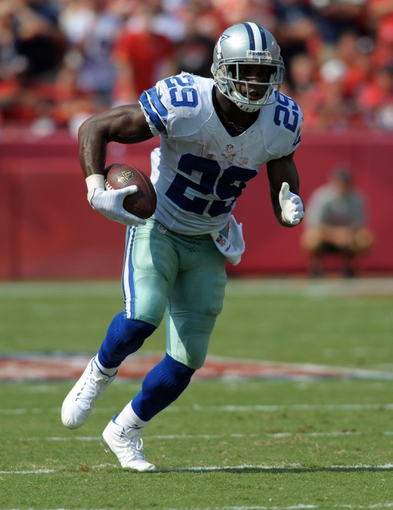 Sep 15, 2013; Kansas City, MO, USA; Dallas Cowboys running back DeMarco Murray (29) runs for yardage during the second half of the game against the Kansas City Chiefs at Arrowhead Stadium. The Chiefs won 17-16. Mandatory Credit: Denny Medley-USA TODAY Sports