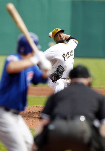Sep 15, 2013; Pittsburgh, PA, USA; Pittsburgh Pirates starting pitcher Francisco Liriano (47) pitches against Chicago Cubs starting pitcher Travis Wood (37) during the sixth inning at PNC Park. The Pittsburgh Pirates won 3-2. Mandatory Credit: Charles LeClaire-USA TODAY Sports