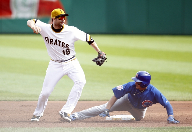 Sep 15, 2013; Pittsburgh, PA, USA; Pittsburgh Pirates second baseman Neil Walker (18) throws too late after forcing out Chicago Cubs second baseman Darwin Barney (bottom) during the sixth inning at PNC Park. The Pittsburgh Pirates won 3-2.
