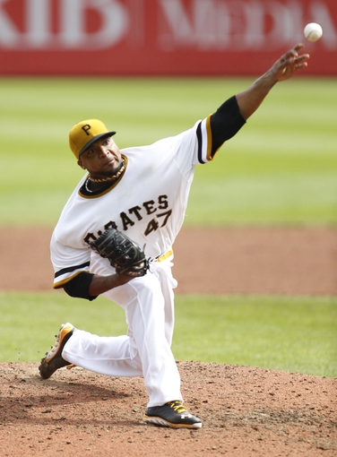 Sep 15, 2013; Pittsburgh, PA, USA; Pittsburgh Pirates starting pitcher Francisco Liriano (47) pitches against the Chicago Cubs during the sixth inning at PNC Park. The Pittsburgh Pirates won 3-2. Mandatory Credit: Charles LeClaire-USA TODAY Sports
