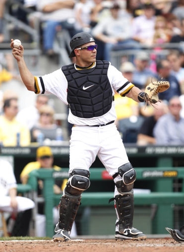 Sep 15, 2013; Pittsburgh, PA, USA; Pittsburgh Pirates catcher Tony Sanchez (59) returns the ball to the pitcher against the Chicago Cubs during the seventh inning at PNC Park. The Pittsburgh Pirates won 3-2.Mandatory Credit: Charles LeClaire-USA TODAY Sports