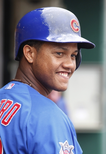 Sep 15, 2013; Pittsburgh, PA, USA; Chicago Cubs shortstop Starlin Castro (13) reacts in the dugout against the Pittsburgh Pirates during the seventh inning at PNC Park. The Pittsburgh Pirates won 3-2. Mandatory Credit: Charles LeClaire-USA TODAY Sports