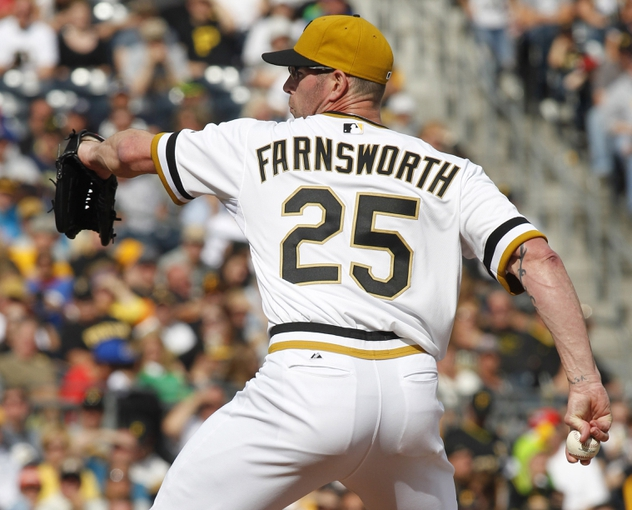 Sep 15, 2013; Pittsburgh, PA, USA; Pittsburgh Pirates relief pitcher Kyle Farnsworth (25) pitches against the Chicago Cubs during the eighth inning at PNC Park. The Pittsburgh Pirates won 3-2. Mandatory Credit: Charles LeClaire-USA TODAY Sports