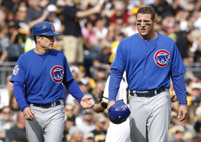 Sep 15, 2013; Pittsburgh, PA, USA; Chicago Cubs first baseman Anthony Rizzo (right) reacts with third base coach David Bell (left) after Rizzo was doubled off of base against the Pittsburgh Pirates during the eighth inning at PNC Park. The Pittsburgh Pirates won 3-2. Mandatory Credit: Charles LeClaire-USA TODAY Sports