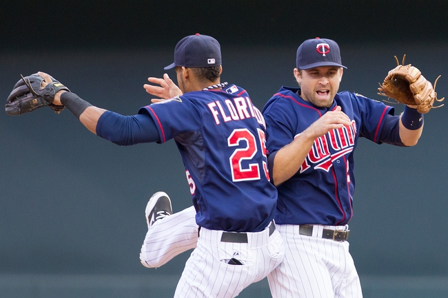 Sep 15, 2013; Minneapolis, MN, USA; The Minnesota Twins shortstop Pedro Florimon (25) and second baseman Brian Dozier (2) celebrate the 6-4 win against the Tampa Bay Rays in the ninth inning at Target Field. Mandatory Credit: Brad Rempel-USA TODAY Sports