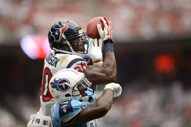 Sep 15, 2013; Houston, TX, USA; Houston Texans wide receiver Andre Johnson (80) catches a pass over Tennessee Titans cornerback Jason McCourty (30) during the second half at Reliant Stadium. The Texans won 30-24. Mandatory Credit: Thomas Campbell-USA TODAY Sports