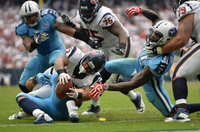 Sep 15, 2013; Houston, TX, USA; Houston Texans running back Arian Foster (23) converts a two-point conversion against the Tennessee Titans during the second half at Reliant Stadium. The Texans won 30-24. Mandatory Credit: Thomas Campbell-USA TODAY Sports