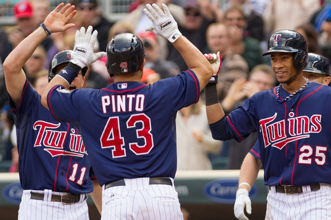 Sep 15, 2013; Minneapolis, MN, USA; The Minnesota Twins catcher Josmil Pinto (43), outfielder Clete Thomas (11), and shortstop Pedro Florimon (25) celebrate after a home run in the eighth inning against the Tampa Bay Rays at Target Field. The Twins won 6-4. Mandatory Credit: Brad Rempel-USA TODAY Sports