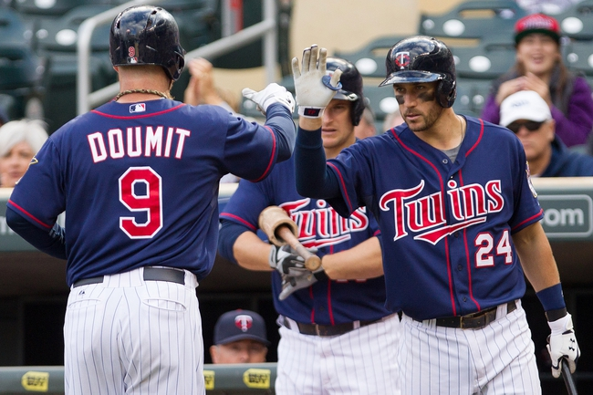 Sep 15, 2013; Minneapolis, MN, USA; The Minnesota Twins designated hitter Ryan Doumit (9) and third baseman Trevor Plouffe (24) celebrate after scoring a run in the eighth inning against the Tampa Bay Rays at Target Field. The Twins won 6-4. Mandatory Credit: Brad Rempel-USA TODAY Sports
