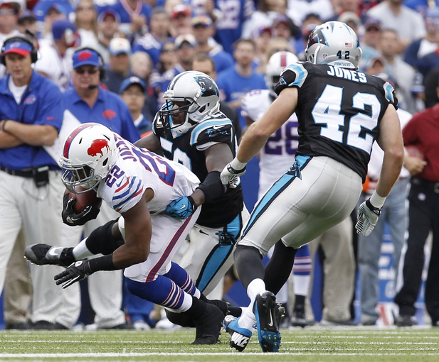 Sep 15, 2013; Orchard Park, NY, USA; Carolina Panthers middle linebacker Luke Kuechly (59) tackles Buffalo Bills running back Fred Jackson (22) during the second half at Ralph Wilson Stadium. Buffalo beat Carolina 27-26. Mandatory Credit: Kevin Hoffman-USA TODAY Sports