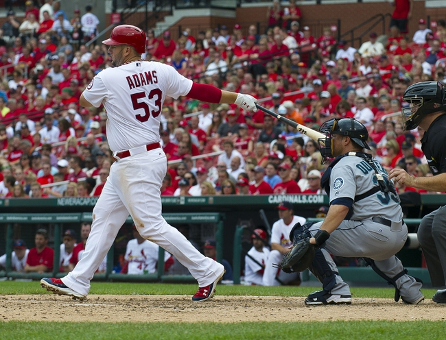Sep 15, 2013; St. Louis, MO, USA; St. Louis Cardinals first baseman Matt Adams (53) hits a single against the Seattle Mariners at Busch Stadium. The Cardinals defeated the Mariners 12-2. Mandatory Credit: Scott Rovak-USA TODAY Sports