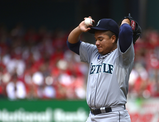 Sep 15, 2013; St. Louis, MO, USA;  Seattle Mariners starting pitcher Erasmo Ramirez (50) reacts after giving up a single to the St. Louis Cardinals during the third inning  at Busch Stadium. The Cardinals defeated the Mariners 12-2. Mandatory Credit: Scott Rovak-USA TODAY Sports