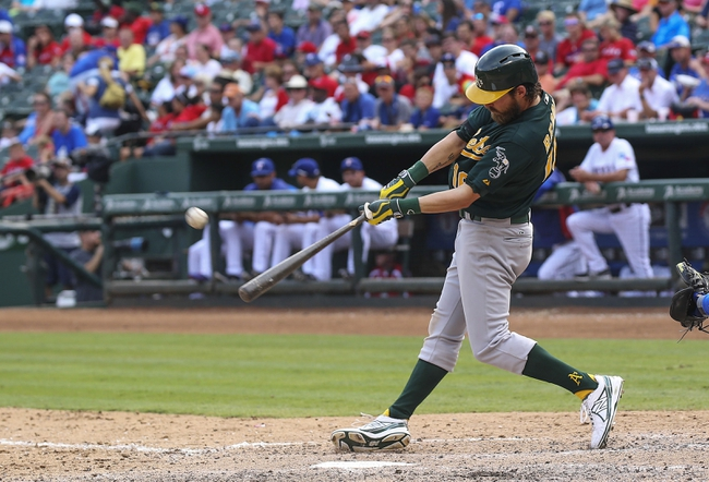 Sep 15, 2013; Arlington, TX, USA; Oakland Athletics right fielder Josh Reddick (16) hits a home run during the ninth inning against the Texas Rangers at Rangers Ballpark in Arlington. Mandatory Credit: Kevin Jairaj-USA TODAY Sports
