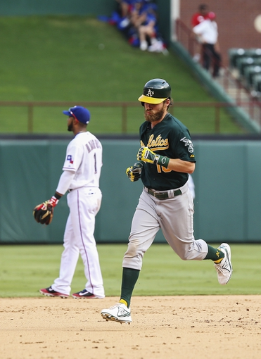Sep 15, 2013; Arlington, TX, USA; Oakland Athletics right fielder Josh Reddick (16) runs the bases after hitting a home run during the ninth inning as Texas Rangers shortstop Elvis Andrus (1) looks on at Rangers Ballpark in Arlington. Mandatory Credit: Kevin Jairaj-USA TODAY Sports