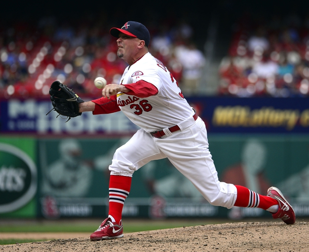 Sep 15, 2013; St. Louis, MO, USA; St. Louis Cardinals relief pitcher Randy Choate (36) delivers a pitch against the Seattle Mariners at Busch Stadium. The Cardinals defeated the Mariners 12-2. Mandatory Credit: Scott Rovak-USA TODAY Sports