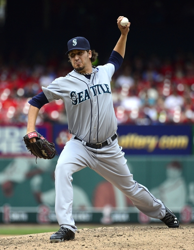 Sep 15, 2013; St. Louis, MO, USA; Seattle Mariners relief pitcher Bobby LaFromboise (30) delivers a pitch against the St. Louis Cardinals at Busch Stadium. The Cardinals defeated the Mariners 12-2. Mandatory Credit: Scott Rovak-USA TODAY Sports
