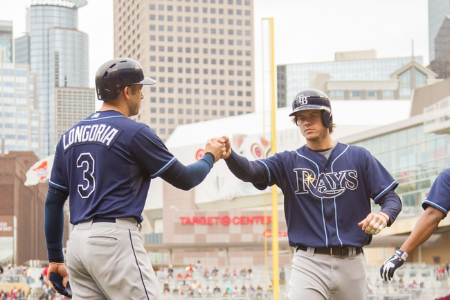 Sep 15, 2013; Minneapolis, MN, USA; The Tampa Bay Rays right fielder Wil Myers (9) gets congratulated by third baseman Evan Longoria (3) after his home run in the fourth inning against the Minnesota Twins at Target Field. Mandatory Credit: Brad Rempel-USA TODAY Sports