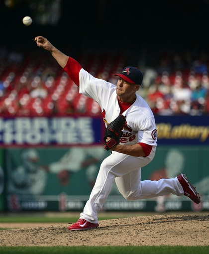 Sep 15, 2013; St. Louis, MO, USA; St. Louis Cardinals relief pitcher Trevor Rosenthal (26) delivers a pitch against the Seattle Mariners during the ninth inning at Busch Stadium. The Cardinals defeated the Mariners 12-2. Mandatory Credit: Scott Rovak-USA TODAY Sports