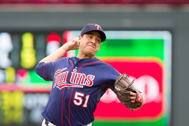 Sep 15, 2013; Minneapolis, MN, USA; The Minnesota Twins pitcher Anthony Swarzak (51) throws a pitch in the sixth inning against the Tampa Bay Rays at Target Field.