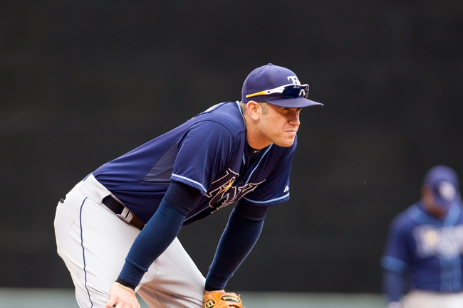 Sep 15, 2013; Minneapolis, MN, USA; The Tampa Bay Rays third baseman Evan Longoria (3) watches the play from third base in the eighth inning against the Minnesota Twins at Target Field. Twins win 6-4. Mandatory Credit: Brad Rempel-USA TODAY Sports