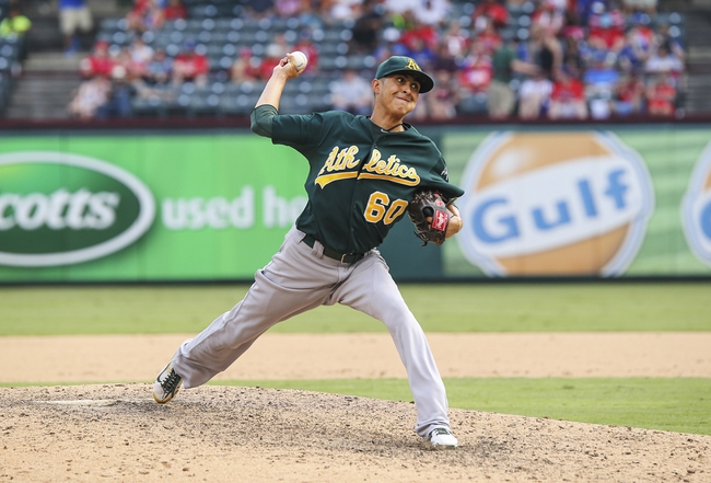 Sep 15, 2013; Arlington, TX, USA; Oakland Athletics relief pitcher Jesse Chavez (60) throws during the game against the Texas Rangers at Rangers Ballpark in Arlington. Mandatory Credit: Kevin Jairaj-USA TODAY Sports