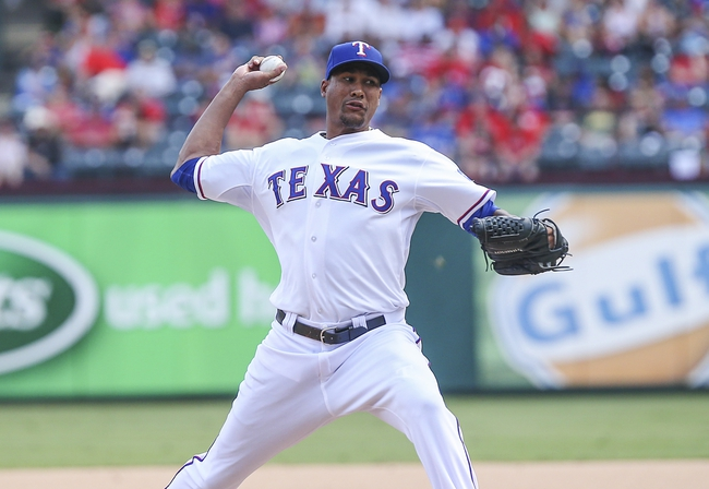 Sep 15, 2013; Arlington, TX, USA; Texas Rangers starting pitcher Alexi Ogando (41) throws during the game against the Oakland Athletics at Rangers Ballpark in Arlington. Mandatory Credit: Kevin Jairaj-USA TODAY Sports