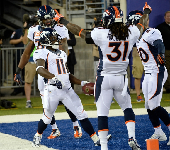 Sep 15, 2013; East Rutherford, NJ, USA; Denver Broncos wide receiver Trindon Holliday (11) celebrates with teammates after scoring a touchdown against the New York Giants in the 4th quarter during the game at MetLife Stadium. Mandatory Credit: Robert Deutsch-USA TODAY Sports