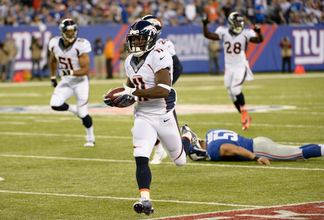Sep 15, 2013; East Rutherford, NJ, USA; Denver Broncos wide receiver Trindon Holliday (11) scores a touchdown against the New York Giants in the 4th quarter during the game at MetLife Stadium. Mandatory Credit: Robert Deutsch-USA TODAY Sports