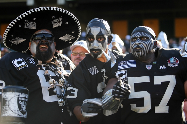 Sep 15, 2013; Oakland, CA, USA; Oakland Raiders fans Se or Raiderman, Darth Dee and Violate after the win against the Jacksonville Jaguars at O.co Coliseum. The Oakland Raiders defeated the Jacksonville Jaguars 19-9. Mandatory Credit: Kelley L Cox-USA TODAY Sports