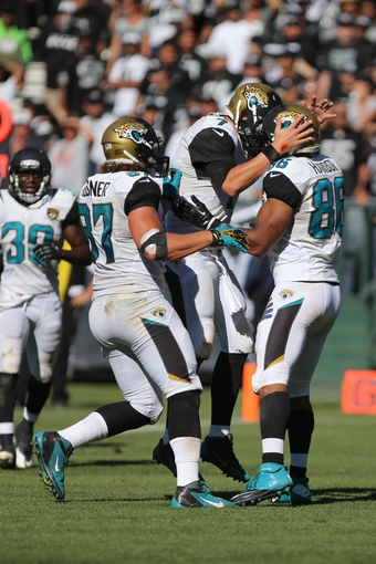 Sep 15, 2013; Oakland, CA, USA; Jacksonville Jaguars quarterback Chad Henne (7) celebrates with tight end Clay Harbor (86) after making the touchdown reception against the Oakland Raiders during the fourth quarter at O.co Coliseum. The Oakland Raiders defeated the Jacksonville Jaguars 19-9. Mandatory Credit: Kelley L Cox-USA TODAY Sports