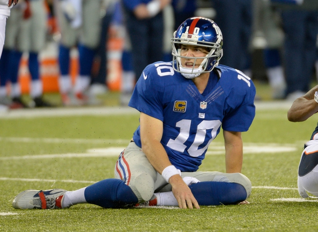 Sep 15, 2013; East Rutherford, NJ, USA; New York Giants quarterback Eli Manning (10) reacts after an incomplete pass against the Denver Broncos during the game at MetLife Stadium. Mandatory Credit: Robert Deutsch-USA TODAY Sports