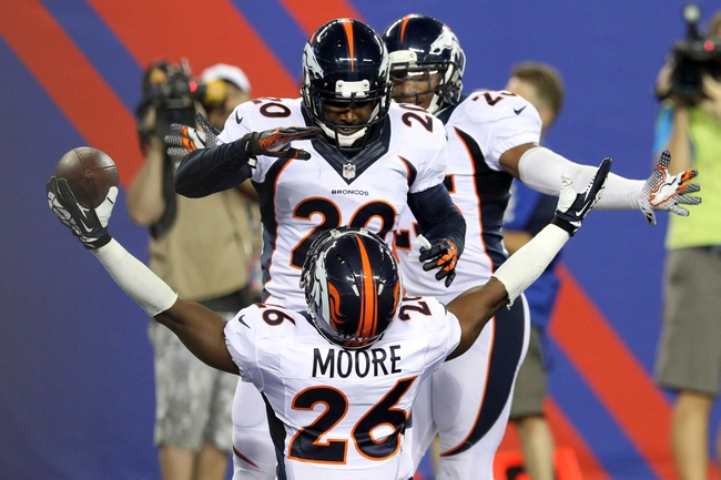 Sep 15, 2013; East Rutherford, NJ, USA; Denver Broncos safety Rahim Moore (26) celebrates an interception with against the New York Giants with Broncos safety Mike Adams (20) during the fourth quarter of a game at MetLife Stadium. The Broncos defeated the Giants 41-23. Mandatory Credit: Brad Penner-USA TODAY Sports