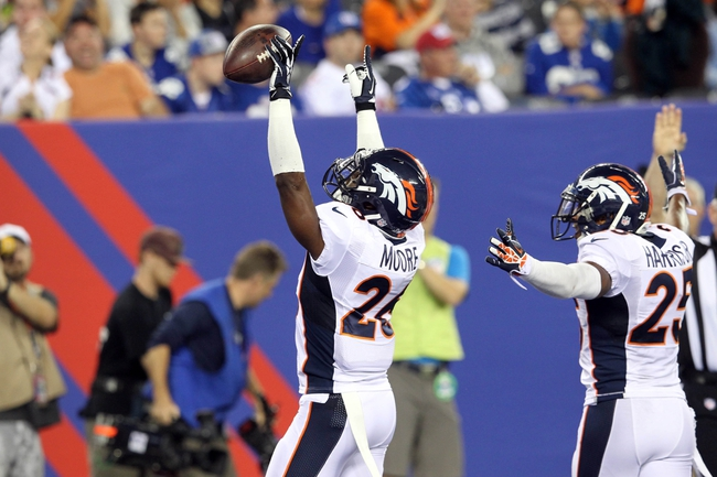 Sep 15, 2013; East Rutherford, NJ, USA; Denver Broncos safety Rahim Moore (26) celebrates an interception against the New York Giants during the fourth quarter of a game at MetLife Stadium. The Broncos defeated the Giants 41-23. Mandatory Credit: Brad Penner-USA TODAY Sports