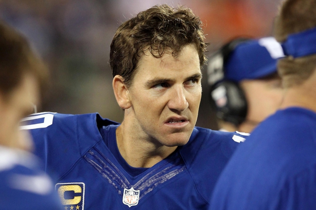 Sep 15, 2013; East Rutherford, NJ, USA; New York Giants quarterback Eli Manning (10) reacts on the sidelines during the fourth quarter of a game against the Denver Broncos at MetLife Stadium. The Broncos defeated the Giants 41-23. Mandatory Credit: Brad Penner-USA TODAY Sports