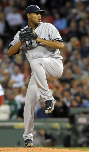Sep 15, 2013; Boston, MA, USA; New York Yankees starting pitcher Ivan Nova (47) pitches during the first inning against the Boston Red Sox at Fenway Park. Mandatory Credit: Bob DeChiara-USA TODAY Sports