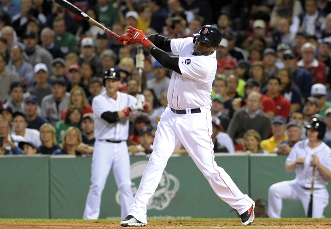Sep 15, 2013; Boston, MA, USA; Boston Red Sox designated hitter David Ortiz (34) hits an RBI single during the first inning against the New York Yankees at Fenway Park. Mandatory Credit: Bob DeChiara-USA TODAY Sports