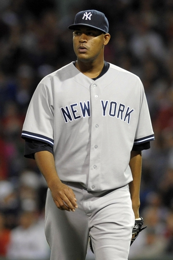 Sep 15, 2013; Boston, MA, USA; New York Yankees starting pitcher Ivan Nova (47) walks off the mound after pitching in the first inning against the Boston Red Sox at Fenway Park. Mandatory Credit: Bob DeChiara-USA TODAY Sports