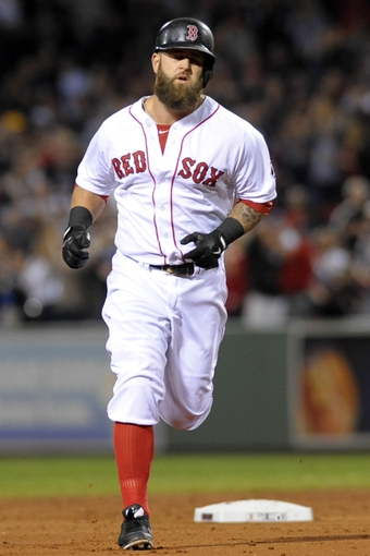 Sep 15, 2013; Boston, MA, USA; Boston Red Sox first baseman Mike Napoli (12) rounds the bases after hitting a two run home run during the first inning against the New York Yankees at Fenway Park. Mandatory Credit: Bob DeChiara-USA TODAY Sports