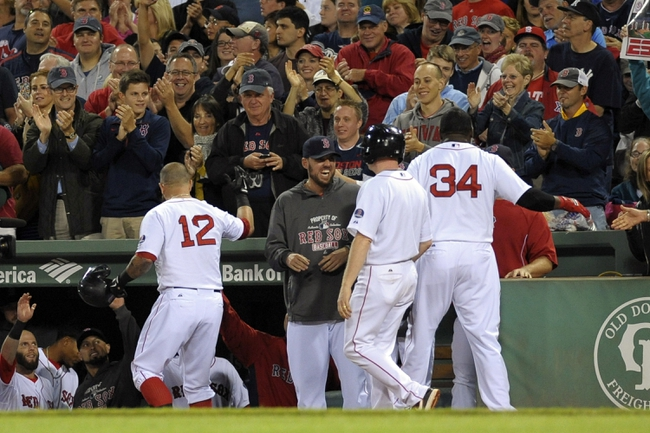 Sep 15, 2013; Boston, MA, USA; Boston Red Sox first baseman Mike Napoli (12) is congratulated by his teammates after hitting a two run home run during the first inning against the New York Yankees at Fenway Park. Mandatory Credit: Bob DeChiara-USA TODAY Sports
