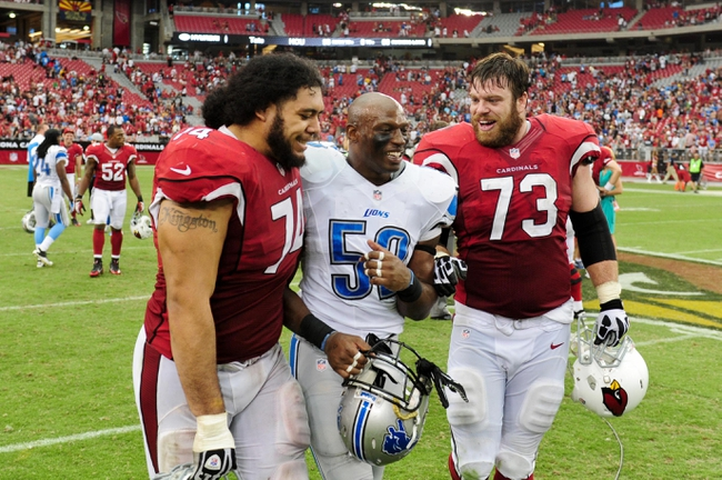 Sep 15, 2013; Phoenix, AZ, USA; Arizona Cardinals guard Paul Fanaika (74) and tackle Eric Winston (73) talk with Detroit Lions linebacker Rocky McIntosh (52) after the game at University of Phoenix Stadium. Mandatory Credit: Matt Kartozian-USA TODAY Sports