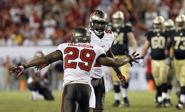 Sep 15, 2013; Tampa, FL, USA; Tampa Bay Buccaneers cornerback Darrelle Revis (24) is congratulated by cornerback Leonard Johnson (29) after he broke up a pass against the New Orleans Saints during the second half at Raymond James Stadium. The Saints won 16-14. Mandatory Credit: Kim Klement-USA TODAY Sports