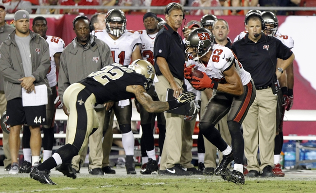 Sep 15, 2013; Tampa, FL, USA; Tampa Bay Buccaneers wide receiver Vincent Jackson (83) runs with the ball as New Orleans Saints strong safety Kenny Vaccaro (32) defends during the second half at Raymond James Stadium. The Saints won 16-14. Mandatory Credit: Kim Klement-USA TODAY Sports