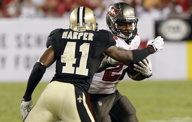 Sep 15, 2013; Tampa, FL, USA; Tampa Bay Buccaneers running back Doug Martin (22) runs with the ball as New Orleans Saints strong safety Roman Harper (41) defends during the second half at Raymond James Stadium. The Saints won 16-14. Mandatory Credit: Kim Klement-USA TODAY Sports