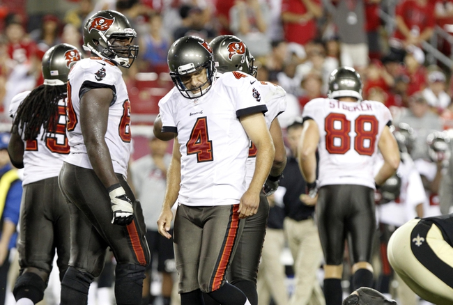 Sep 15, 2013; Tampa, FL, USA; Tampa Bay Buccaneers kicker Rian Lindell (4) reacts after he missed a field goal during the fourth quarter against the New Orleans Saints  at Raymond James Stadium. The Saints won 16-14. Mandatory Credit: Kim Klement-USA TODAY Sports