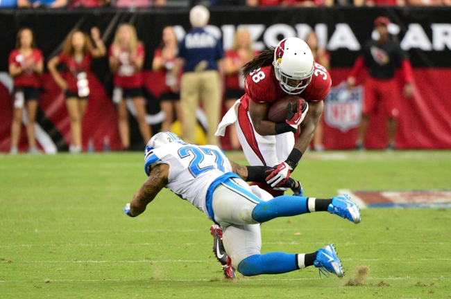 Sep 15, 2013; Phoenix, AZ, USA; Arizona Cardinals running back Andre Ellington (38) runs with the ball as Detroit Lions strong safety Glover Quin (27) defends during the second half at University of Phoenix Stadium. Mandatory Credit: Matt Kartozian-USA TODAY Sports
