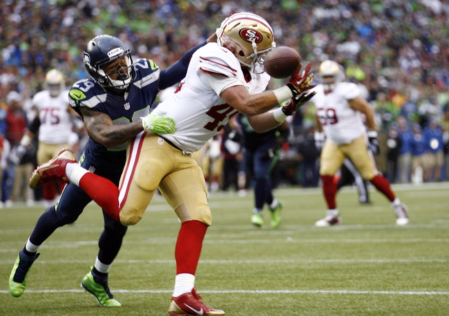 Sep 15, 2013; Seattle, WA, USA; Seattle Seahawks free safety Earl Thomas (29) defends a pass intended for San Francisco 49ers fullback Bruce Miller (49) during the first quarter at CenturyLink Field. Mandatory Credit: Joe Nicholson-USA TODAY Sports