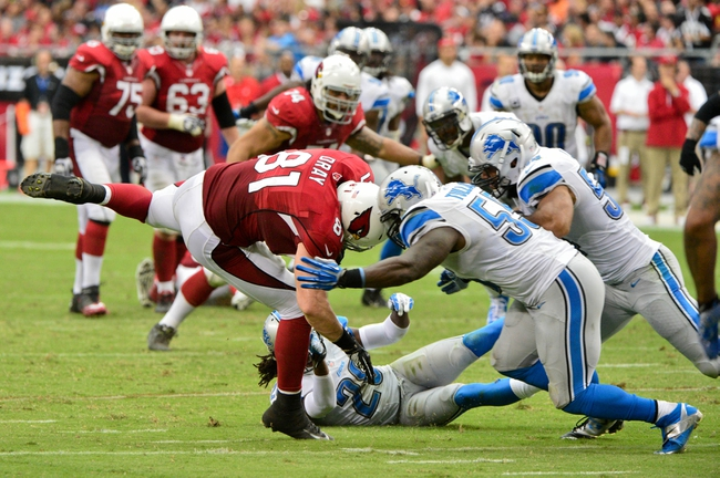 Sep 15, 2013; Phoenix, AZ, USA; Arizona Cardinals tight end Jim Dray (81) is tackled by Detroit Lions cornerback Bill Bentley (28) and middle linebacker Stephen Tulloch (55) during the second half at University of Phoenix Stadium. Mandatory Credit: Matt Kartozian-USA TODAY Sports
