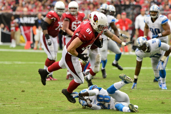 Sep 15, 2013; Phoenix, AZ, USA; Arizona Cardinals tight end Jim Dray (81) tries to break a tackle by Detroit Lions cornerback Bill Bentley (28) during the second half at University of Phoenix Stadium. Mandatory Credit: Matt Kartozian-USA TODAY Sports