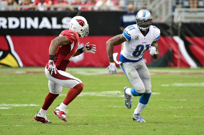 Sep 15, 2013; Phoenix, AZ, USA; Arizona Cardinals cornerback Patrick Peterson (21) covers Detroit Lions wide receiver Calvin Johnson (81) during the second half at University of Phoenix Stadium. Mandatory Credit: Matt Kartozian-USA TODAY Sports
